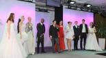 Blick auf die Bühne mit Models und Philipp Pertl